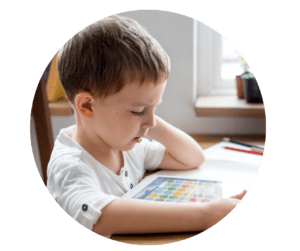 child complete schoolwork on tablet