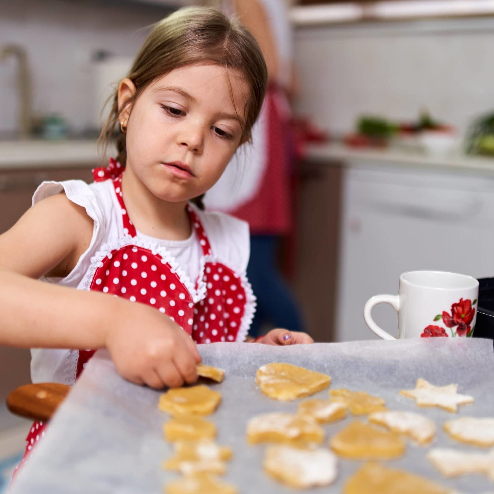 Young,Girl,Making,Gingerbread,Cookies,At,Home